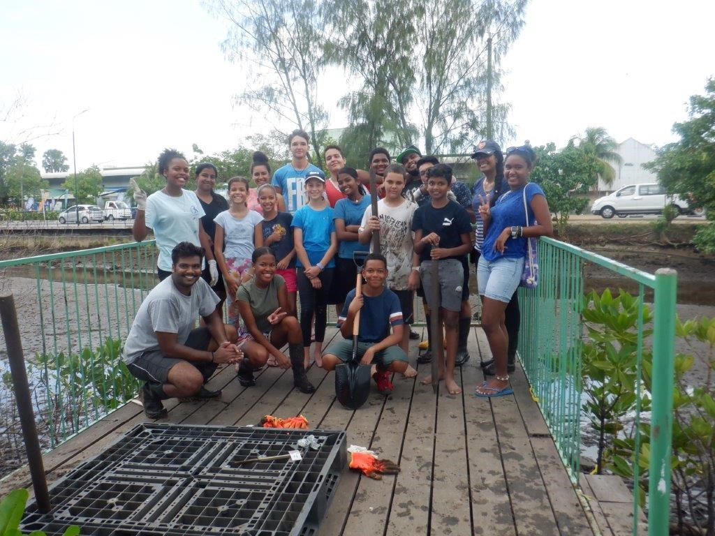 Rising Lions Club members and ISS Eco club planted mangroves in the wetlands